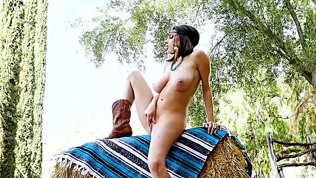 Sexy farm girl masturbates in cowboy boots
