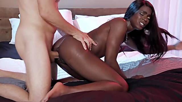 Lithe black hottie fucked doggy style by a big white dick