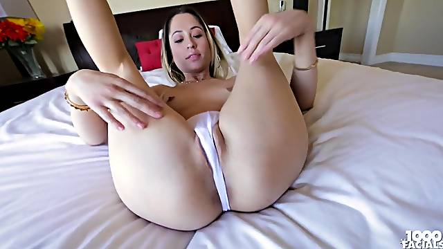 Cutie in a thong teasing her ass and sucking dick