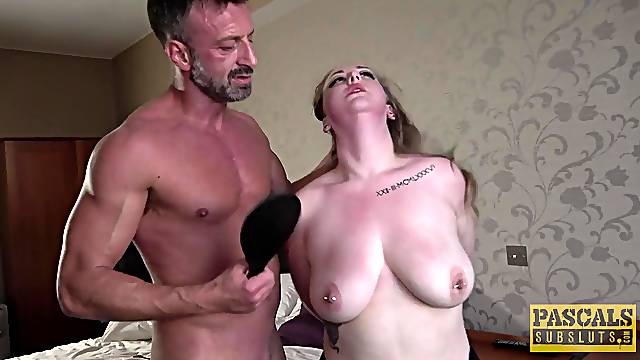 Serious maledom porn for a busty MILF with pierced tits