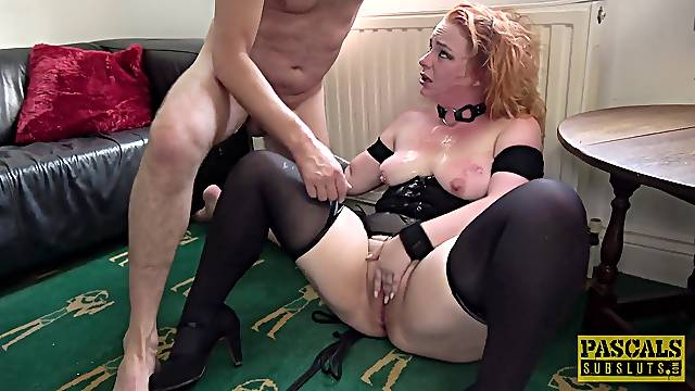 Redhead acts submissive while the man prepares to fuck her fat ass