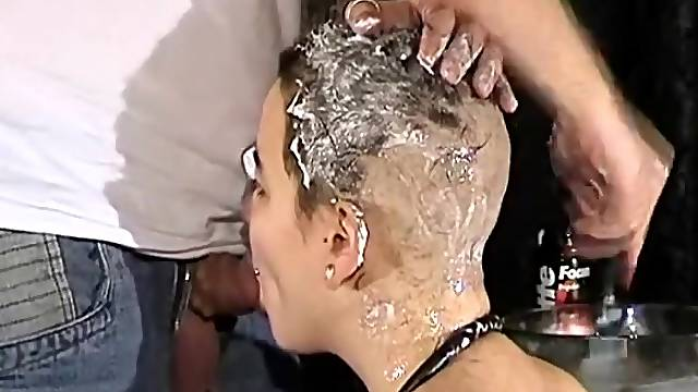 Shaving her head as she sucks his dick