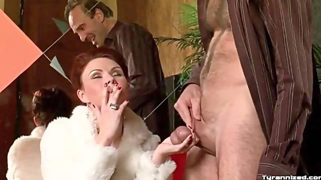 Smoking mistress plays rough with his balls