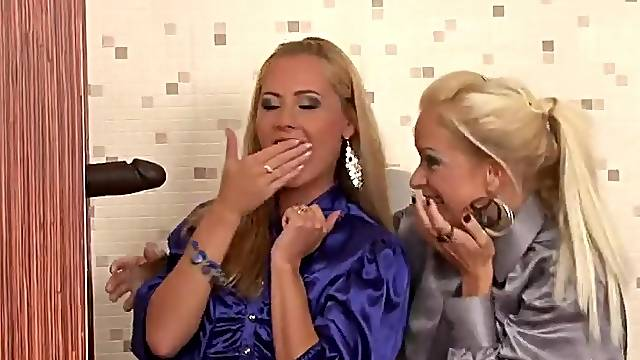 Two Blondes Covered In Gloryhole Cum
