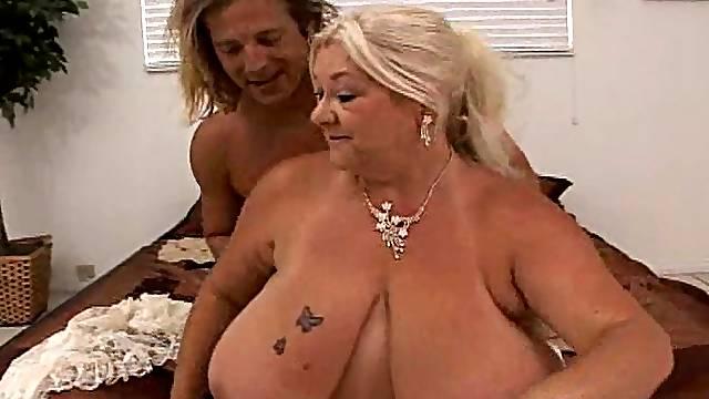 A fat old-ass skank with big saggy tits sucks dick