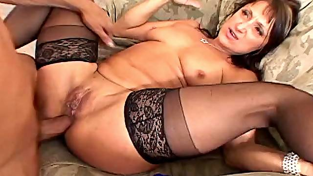Mature brunette's fucked while wearing stockings